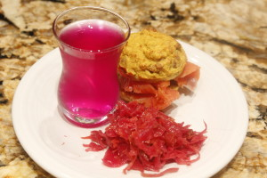 Coconut muffin with smoked salmon, ruby kraut, and beet kvass.