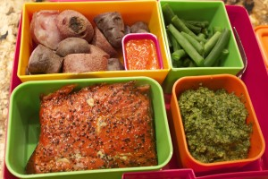 Smoked salmon, purple potatoes, green beans, purple potatoes, pesto, pepper sauce